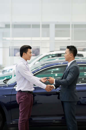 Salesman shaking hand of customer