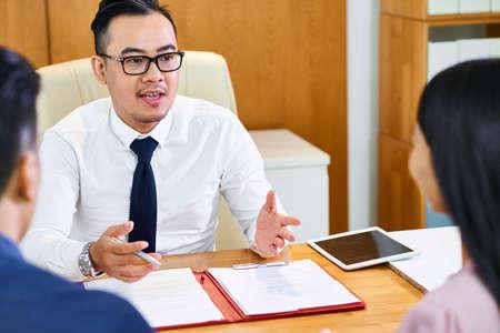 Estate agent consulting couple