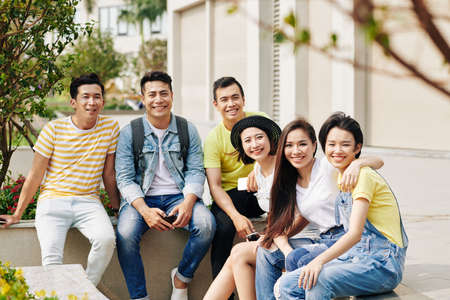Happy Vietnamese young people spending time together outdoors Stockfoto