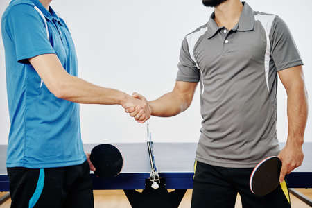 Cropped image of tennis table players shaking hands after game Imagens