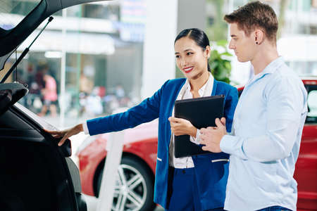 Customer asking car dealership manager to open trunk so he could look inside