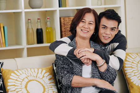 Young man hugging his mother 版權商用圖片