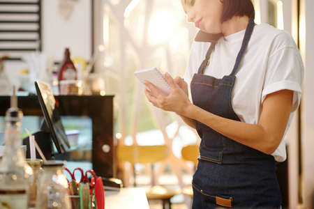 Waitress accepting order on phone