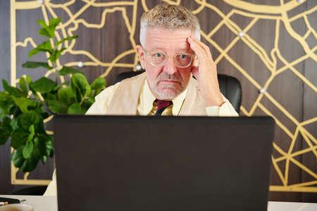 Shoked businessman reading report