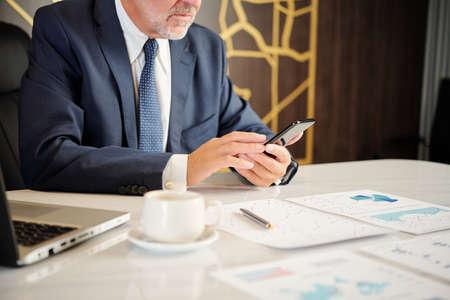Entrepreneur checking phone