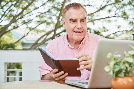 Senior man checking planner