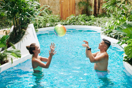 Couple playing in pool