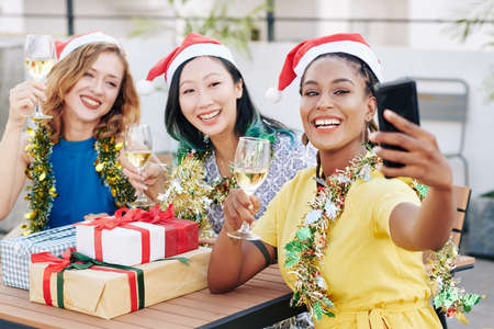 Taking selfie at Christmas party Stock Photo