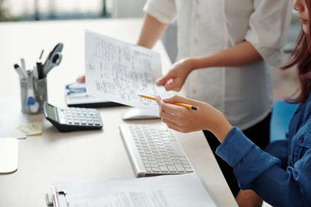 Businessman showing coworker chart illustarting company development ideas