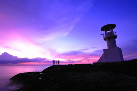 illuminative: Lighthouse searchlight beam through marine air at night Stock Photo