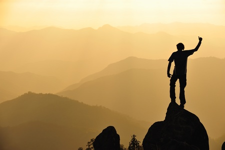Silhouette of man in mountain  Conceptual scene  photo