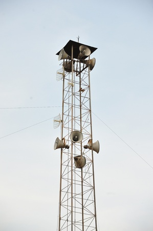 Speaker on high tower and clear sky photo