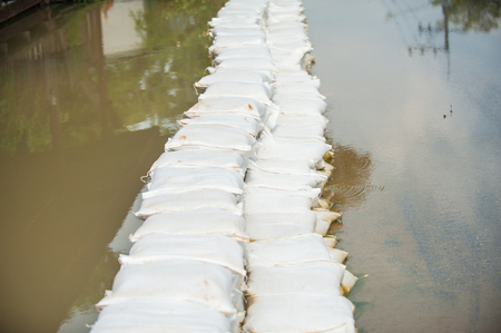 Sandbags stacked in thailand flooded street  photo