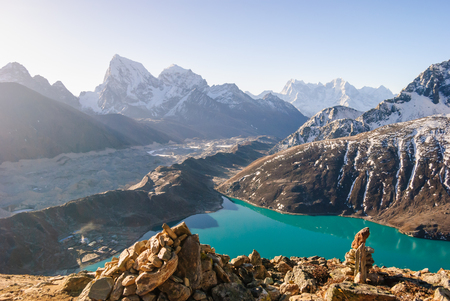 dole: Ngozumpa Glacier flowing down from the high snow capped mountains of the Himalayas. View from Gokyo Ri, 5360 meters up in the Himalaya Mountains of Nepal Stock Photo