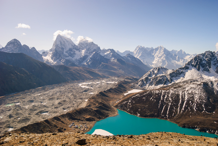 ri: Ngozumpa Glacier flowing down from the high snow capped mountains of the Himalayas. View from Gokyo Ri, 5360 meters up in the Himalaya Mountains of Nepal Stock Photo