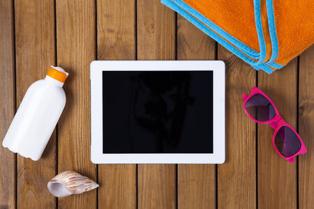 tablet pc on the deck with summer concept photo