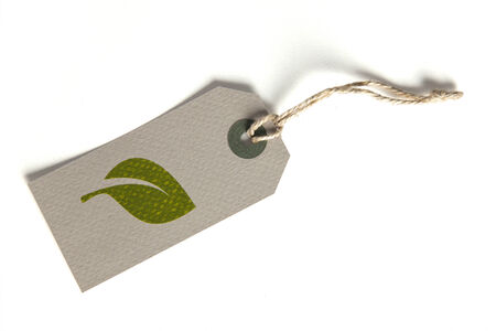 Tag with environmentally-themed, leaf symbol on it photo