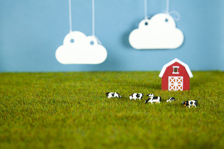Toy farm with barn and cows