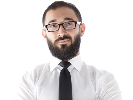 cool guy: bearded and wearing glasses businessman looking in to camera
