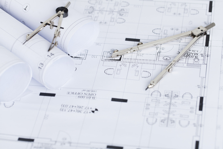 printout: Construction planning drawings on the table and two drawing compasses