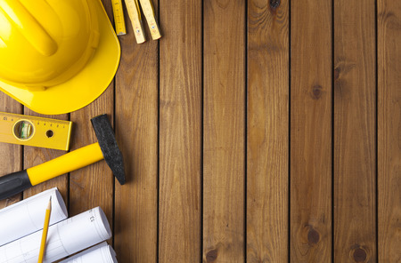 Construction tools on a wooden background Banco de Imagens - 83044850