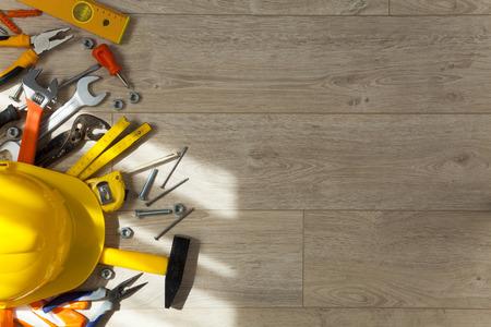 Set of work tools on wood panel background