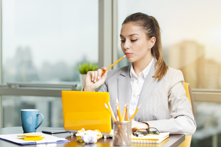 businesswear: Portrait of a serious businesswoman using laptop in office