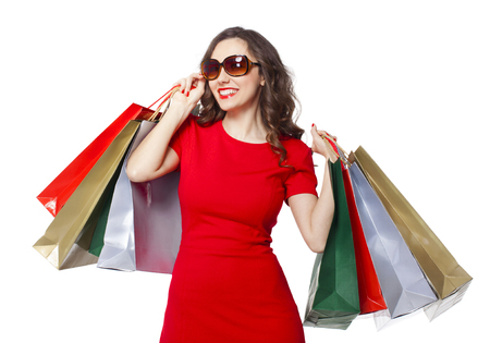 Shopping woman holding shopping bags on isolated white background