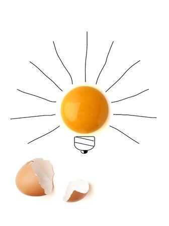 Egg yolk ball forming a shape of illuminated light bulb on isolated white background Stock Photo