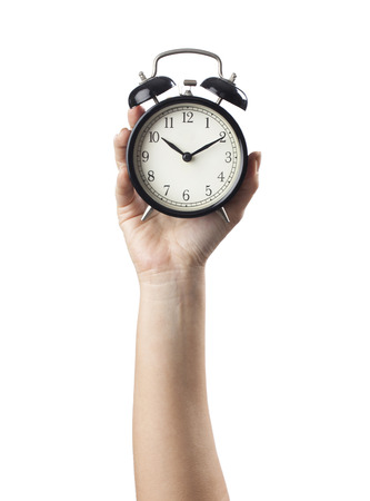 Woman's hand on a white background isolated with an alarm clock