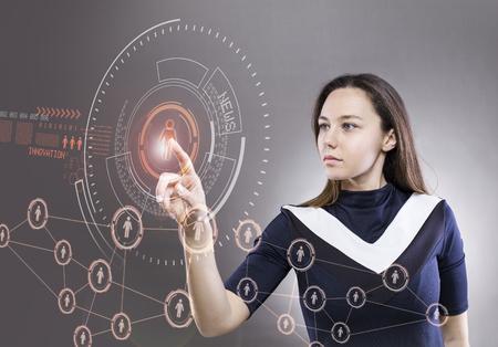 Young woman touching the virtual future interface