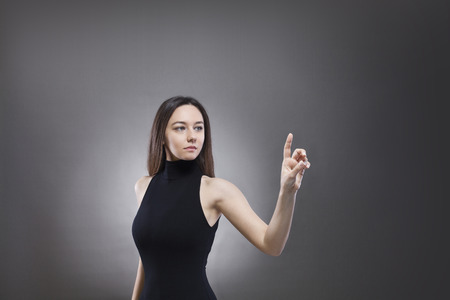 Young woman touching the empty screen