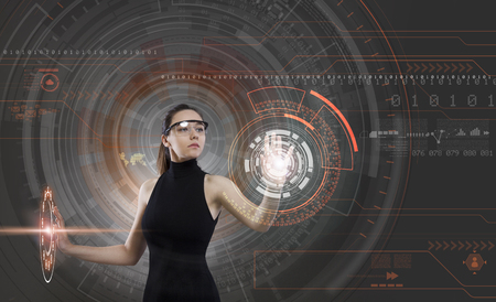 Attractive young woman and technologies of the future Imagens - 124593973