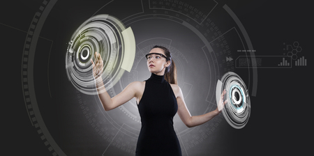 Attractive young woman and technologies of the future Imagens - 124594013