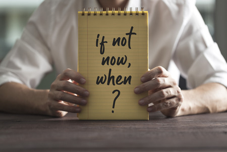 Writing note showing 'If Not Now, When' text. Everyday Inspirational quotes concept.