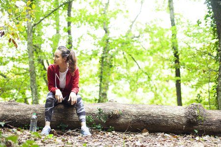 Fit woman athlete resting outdoors