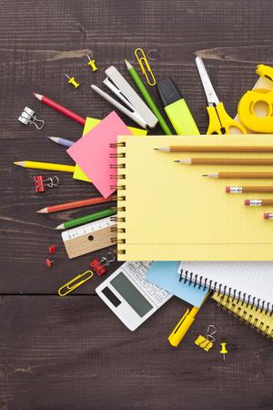 Overhead shot of school supplies on wooden background Фото со стока