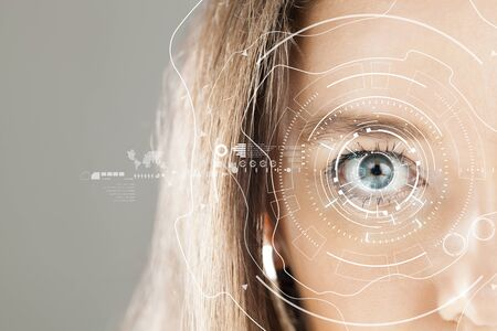 Young woman's eye and high-tech concept, augmented reality display, Iris verification, wearable computing Archivio Fotografico