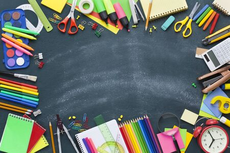 School supplies on blackboard background. Back to school concept Stok Fotoğraf - 128814865