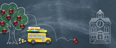 Back to school concept. Yellow school bus passing by the apple tree. Top view banner for your design.