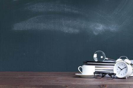 Magnifying glass on notebook stack in classroom. Back to school concept Stok Fotoğraf - 128815040
