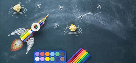 Back to school concept with rocket made out of colored pencil on blackboard Stock fotó