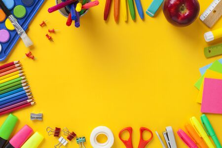School stationery items on yellow background. Back to school concept. Stok Fotoğraf - 128815546