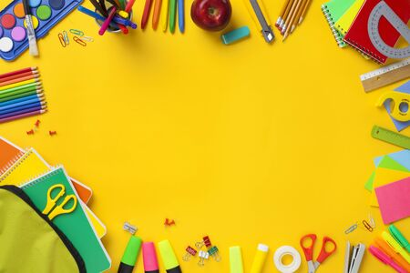 School stationery items on yellow background. Back to school concept. Stok Fotoğraf - 128815554