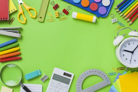 School stationery items on green background. Back to school concept. Stok Fotoğraf