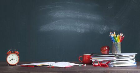 Students desk against blackboard. Back to School concept.