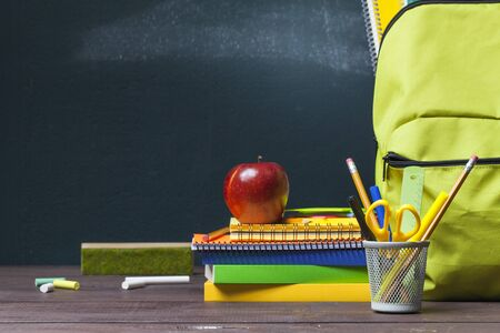Stack of books, stationery and education supplies on wooden desk. Back to school concept. Stok Fotoğraf