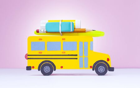 Back to school concept. Paper-cut model yellow school bus on colour background Stok Fotoğraf - 128815766