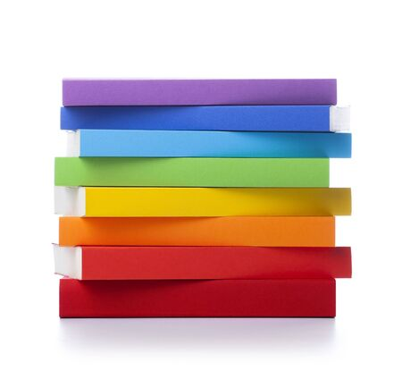 Stack of colored books on white background Banco de Imagens