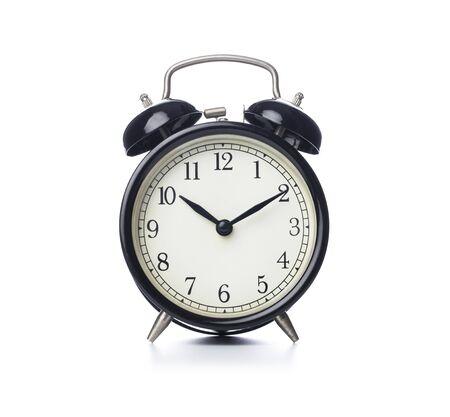 Retro alarm clock on isolated white background Standard-Bild